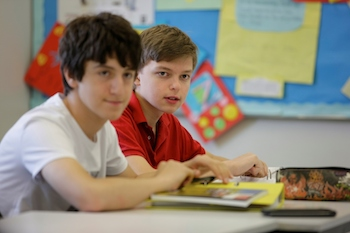 boys studying international middle school