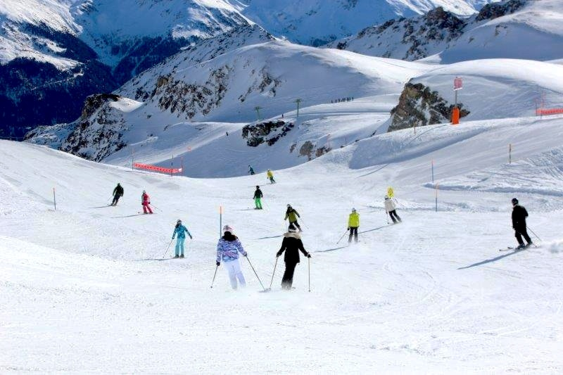 skiing down the slopes in switzerland